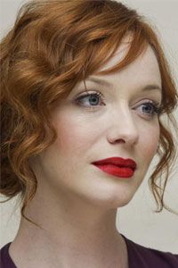 The Botticelli-esque Christina Hendricks, who is 35, looks lovely with a loose updo, modest eye makeup and matte red lipstick.