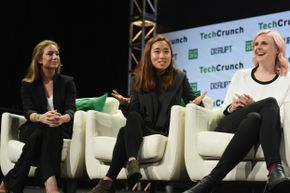 Left to right, co-founder and CEO of Bumble Whitney Wolfe, co-founder and COO of Coffee Meets Bagel Dawoon Kang and Founder of Her Robyn Exton speak onstage during TechCrunch Disrupt NY 2016.