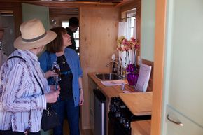 Visitors check out a tiny house interior at the Maker Faire.