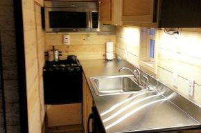 As you can see, the kitchen space is very cramped in tiny houses.