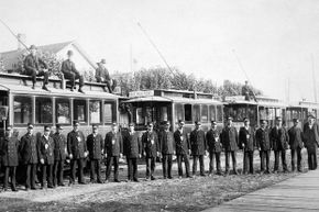 Manistee's history is the central focus of its tourist industry. These streetcar drivers, pictured in 1910, would likely still find some parts of town familiar.