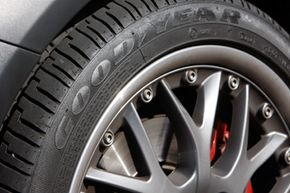 The Goodyear company logo is embossed into the sidewall of an Eagle RS-A tire mounted on a Mini Cooper S in the southeast Denver suburb of Greenwood Village, Colo.