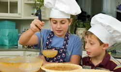 Get kids involved in cooking early -- it could teach them better eating habits.