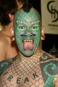 Eric 'Lizard Man' Sprague shows off his split tongue.
