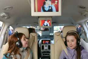 Willa Norris, 8, left, and Hannah Fowler, 10, sit in a 2008 Chrysler Town and Country minivan during a demonstration of Sirius Backseat TV on Thursday, March 29, 2007 in New York.