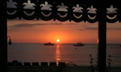 You'll enjoy having a rum punch and watching the sunset in Negril, Jamaica.
