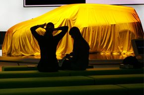 What's under the cover? See pictures of concept cars.
