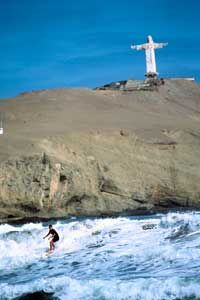 At Chorrillos, three hours north of Lima, local surfers play the waves.