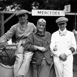 Shown from left to right: Earl Francis Curzon Howe, Captain Malcolm Campbell, and Rudolf Caracciola -- after winning the Irish Grand Prix on July 21, 1930, at Phoenix Park in Dublin, Ireland.