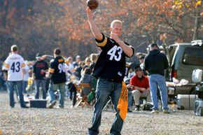A fan of the Pittsburgh Steelers throws a pass while tailgating before play against the Cincinnati Bengals at Heinz Field in Pittsburgh, Pa.