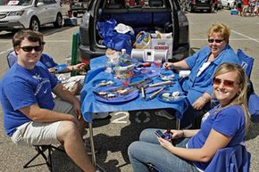 University of Kentucky fans, the Muldoons of Louisville, tailgate outside Cardinal Stadium in Louisville, Ky., before the start of the Kentucky-Louisville NCAA college football game.
