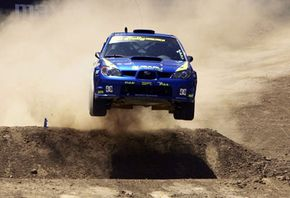 Rally Car racing pushes suspension components to the limit.