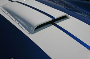 Hood scoops serve a purpose -- to cool the engine compartment and improve performance.