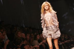 Metallic fabrics and deconstructed styles are popular for summer 2010.