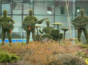 Life-sided topiary figures of the Beatles adorn the traffic island at Liverpool's South Parkway rail station on March 26, 2008, in Liverpool, England.