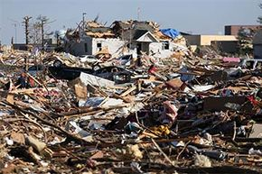 People survey the damage in a subdivision in the aftermath of a tornado on Nov. 18, 2013 in Washington, Illinois.