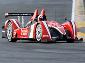 Race car driver Stephane Ortelli whips this Formula Le Mans prototype around a French track in November 2008. The car's 400 horsepower engine should help him pass other drivers with ease.