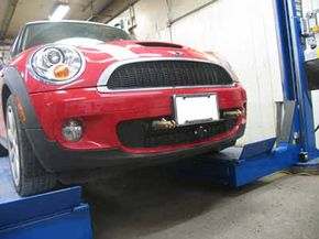 The gold towing base plates on this Mini Cooper were made by Blue Ox, and they can be removed when not in use.