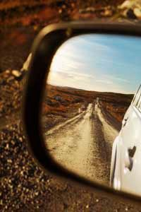 As a general rule of thumb, you should be able to see along the entire length of your trailer in your side view mirrors.