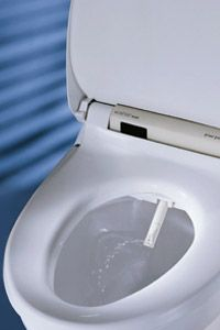 The Washlet's spray wand is user-controlled to adjust the water temperature and pressure.