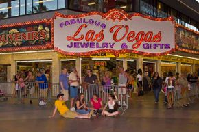 A crowd of people hang out at the Fremont Street Experience in Las Vegas.