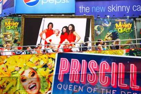 Visitors take a bus tour through the billboards of Times Square.