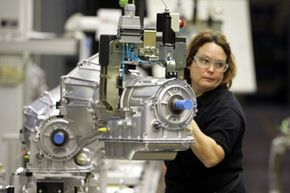 Transmissions Image Gallery Donna Ramsey moves transmissions in the final assembly area at the General Motors Willow Run plant in Ypsilanti, Mich., on Oct. 26, 2005. See more pictures of transmissions.