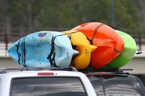 Image Gallery: Car Safety Transporting a kayak on its side will help prevent it from warping because its sides are stronger than its bottom. See more car safety pictures.