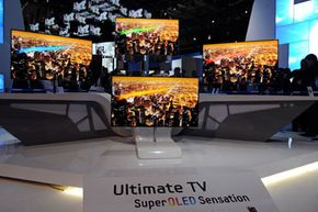 Samsung 55-inch super OLED televisions are displayed at the company's booth at the 2012 International Consumer Electronics Show.