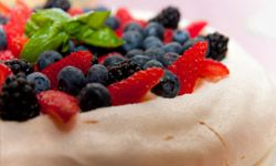 Delicate, soft and filled with fruit, pavlova got its start as a tribute to a dancer.