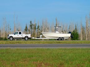 I know, it's such a small thing, but you need a trailer ball so your tiny pick-up can safely bear the weight of hauling that huge boat.