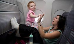Children who are 2 years old or younger can fly for free on many airlines -- as long as they stay in your lap.