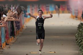 Aaron Barclay of New Zealand celebrates his gold medal win in the Men's Triathlon at the Singapore 2010 Youth Olympics. He won the race -- a 750-meter swim, 20-kilometer bike ride and 5-kilometer run -- in 54 minutes, 41 seconds.