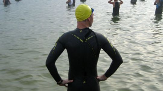 Why is certain gear not permitted in some triathlons?