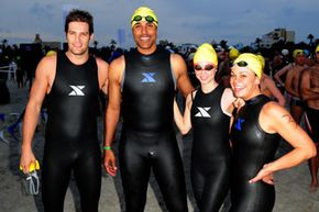 """Four people probably not concerned about their triathlon rankings: actors Geoff Stults, Rick Fox, Eliza Dushku and NBC's """"The Biggest Loser"""" winner Ali Vincent seen at the third annual Nautica South Beach Triathlon on April 11, 2010 in Florida."""