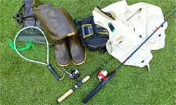 A few of the fishing essentials: fishing poles, net, creel, fishing vest and wading boots.