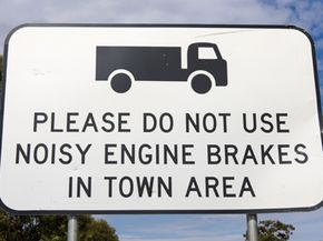 Signs like these apply to big trucks; they have a different brake system than a car.