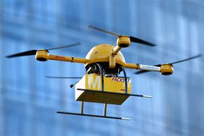 A quadcopter drone arrives with a small delivery at DHL headquarters in Berlin. The company was testing the delivery of medicine from a pharmacy in Bonn.
