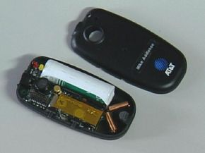 Inside the bat ultrasonic transmitter shows two-copper coil antennae, a radio transmitter module, the battery and two ultrasonic transmitters.
