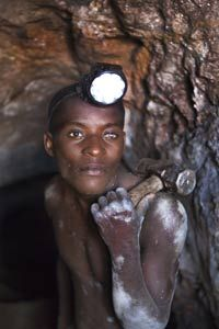 While mining has become much safer in developed countries, it is still very risky in parts of the third world. In Congo, Nsinku Zihindula works 24 hour shifts hammering at solid rock to find cassiterite ore. He was blinded in his left eye by flying rock.
