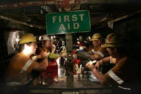 Miners enjoy a lunch break in the makeshift crib rooms at one of Illawarra Coal's underground mines in Australia. See more mining pictures.