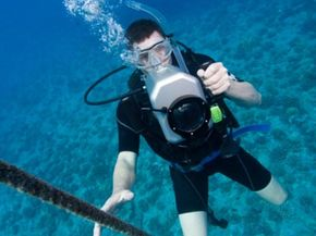 Most professional underwater photographers house their cameras to protect them from damage.