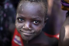 A young boy from the remote Turkana tribe in Northern Kenya waits to be selected for food aid during a drought.