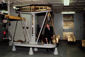 Gold bars are weighed on a giant scale in the gold vault of the Federal Reserve Bank of New York. The people who move this enormous bars are called gold stackers.