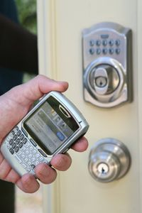 With the Schlage LiNK system, you can use devices like a Web-enabled smartphone to unlock your door. See more pictures of essential gadgets.