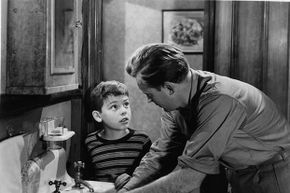 Young Bobby Driscoll looks up at Arthur Kennedy in a scene from 'The Window.' Driscoll died penniless of heart failure and was buried in a pauper's grave.