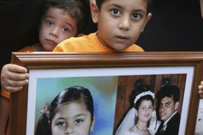 In 2007, 4-year-old Vassilis Koutsoftas held a large frame containing photos of his parents and sister, who were killed in the Helios air crash north of Athens two years earlier.