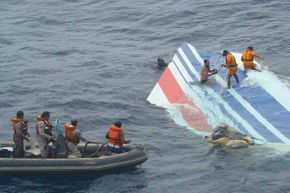 Brazilian Navy divers recover a huge part of the rudder of the Air France Airbus A330 out of the Atlantic Ocean, some 745 miles (1,200 km) northeast of Recife in 2009.