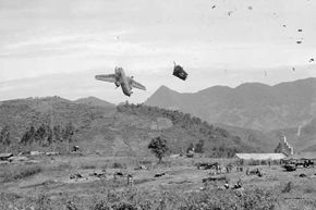 Split seconds after a U.S. Caribou transport plane had been hit by American artillery, UPI photographer Miromichi Mine recorded this remarkable picture as the plane plummeted to earth at Ha Phan, Vietnam. The three crew members were killed.