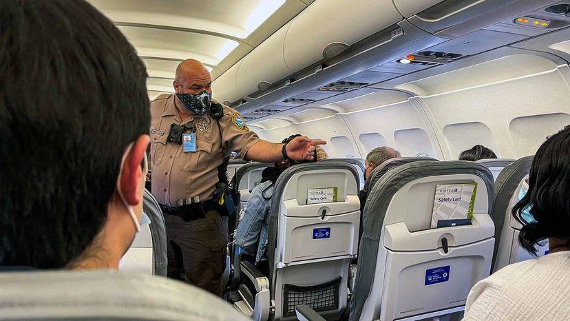 policeman on airplane